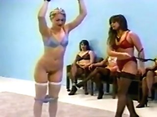 female domination whipping in undergarments (hooter-sling and fullback pantys)