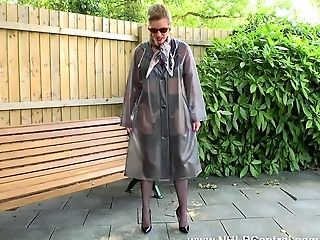 Perverted Mummy Holly Smooch Takes Off Pvc Mac And Wanks Openly On Public Bench In Black Nylons Garters And Fuck Me Stilettos