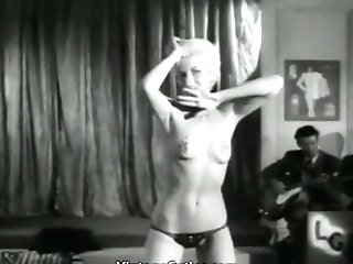 Seductive Blonde Performs a Striptease (1950s Vintage)