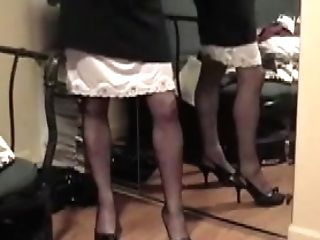 Lifts Mini-skirt To Display Slip And Stockings