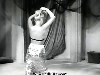 This Tramp With A Vapid Arse Dances And Strips On Stage In This Demonstrate