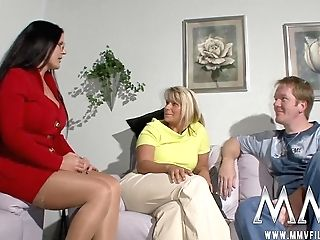 Big-titted Blonde Mom Gives Final Tugjob In Dirty Threesome With Black-haired Bbw In A Crimson Suit