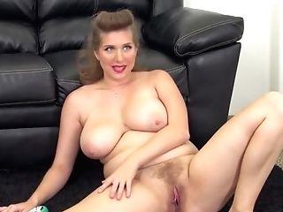 Curvy Antique Lady In Crimson Corsette Masturbates On Couch