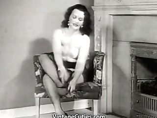 A Plane Chested Dark Haired In Black High-heeled Slippers Strips In A Stool